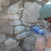 Figure 10. Scraping and cleaning applied mortar (Photo: Azoria Project)