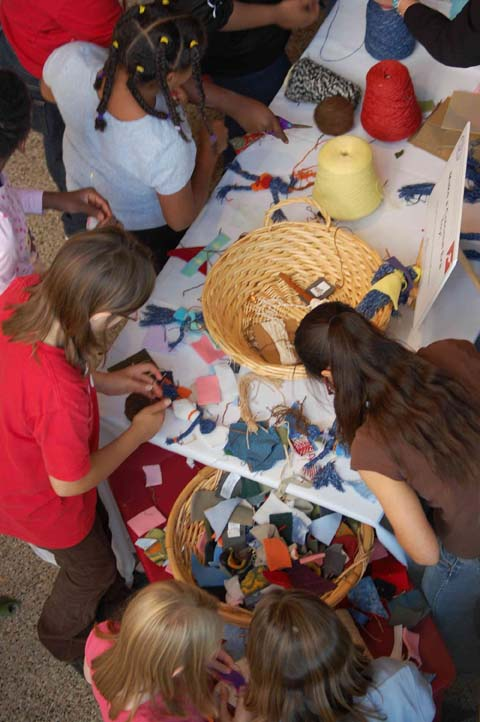 Children make cloth dolls in an activity presented by the American Textile History Museum.