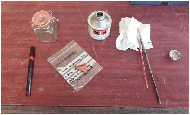 Tools of the trade: acetone (glass jar), varnish (tin), special and practically magical tiny-nib pen, and some brushes.