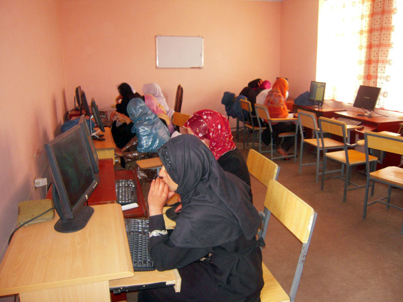 Female students at the computer lab in the new school