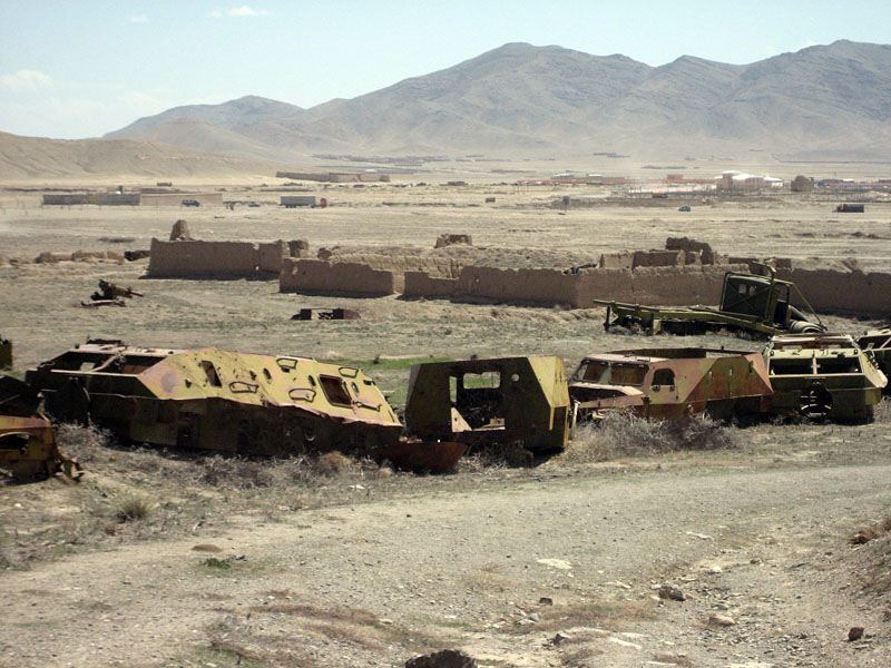 Abandoned Soviet tanks littering the area in front of the palace of Ma'sud III (early 12th c. A.D.), Ghazni