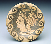 Head of a woman, on the eponymous Genucilia plate, 350-325 BCE. Photography by Erik Gould, courtesy of the Museum of Art, Rhode Island School of Design, Providence