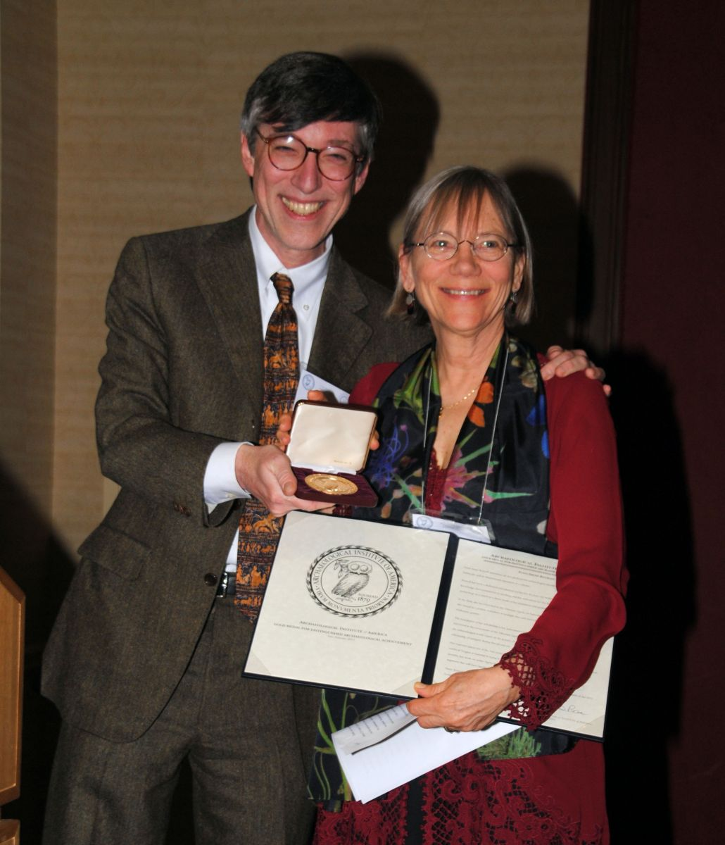 Brian Rose presents Susan Rotroff with the Gold Medal Award