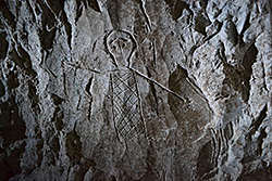 Graffito of human figure carved inside a burial bed in catacomb 1 of the Beit Shearim necropolis, Israel. Photo: Ezra Gabbay